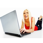 Casual girl browsing on a laptop isolated over white